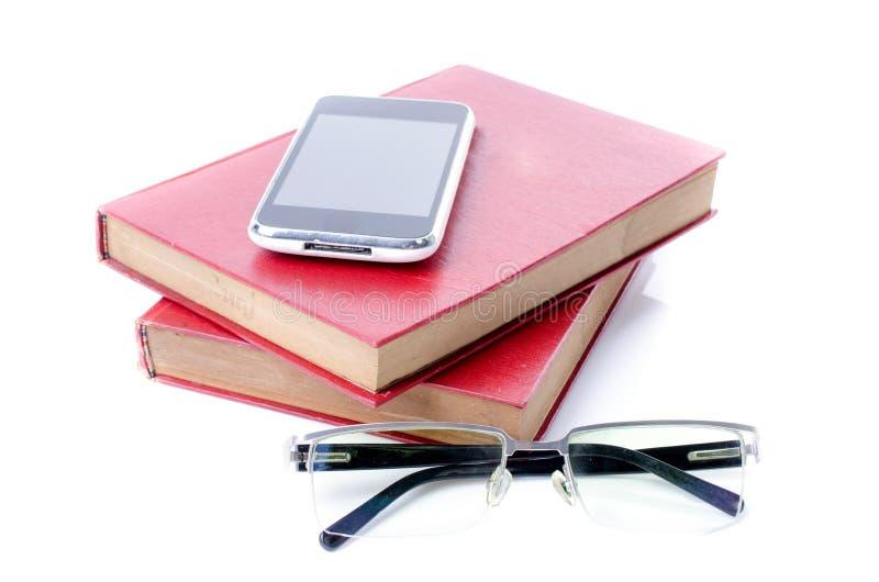 Vidrios elegantes del teléfono y del ojo con el libro rojo foto de archivo libre de regalías