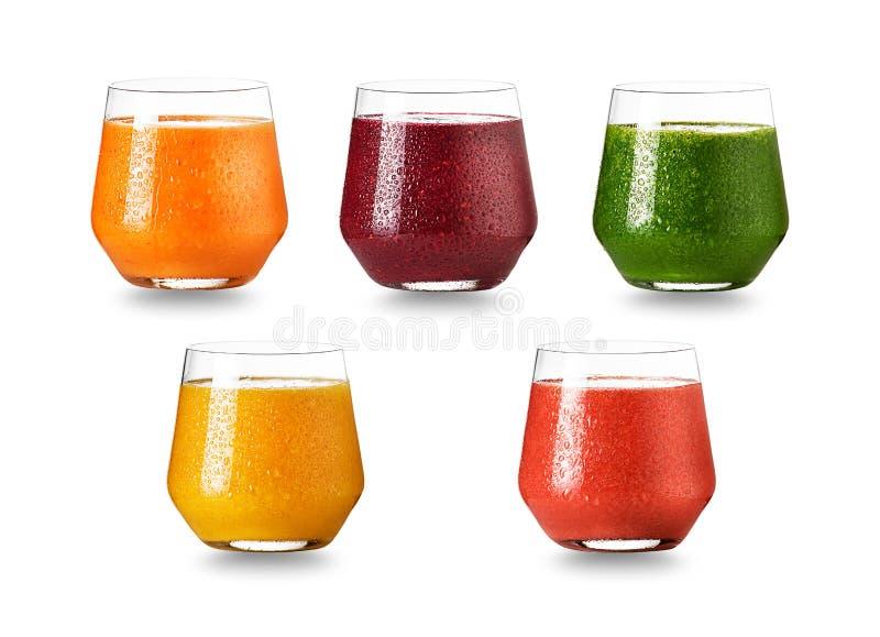 Vidrios mezclados de zumos de fruta fotografía de archivo
