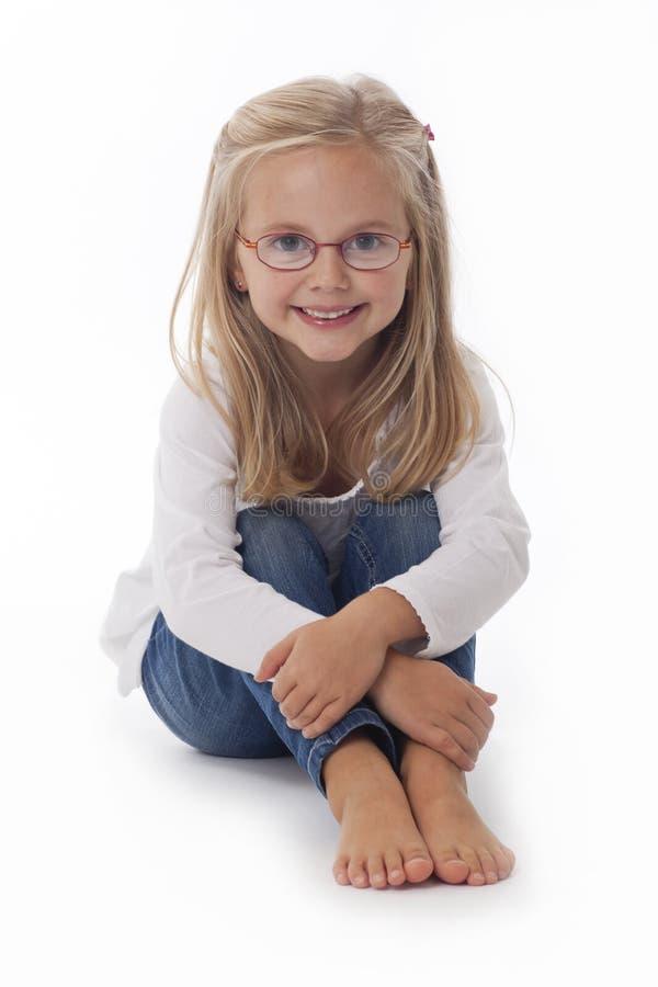 Vidrios que desgastan de la niña foto de archivo libre de regalías