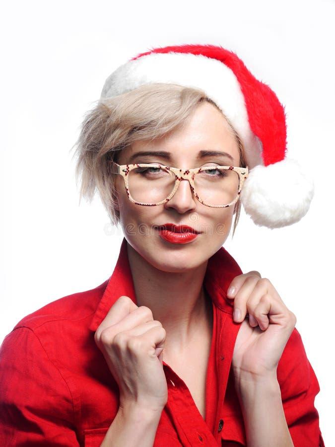 Vidrios que llevan de la mujer y un casquillo de la Navidad imagen de archivo