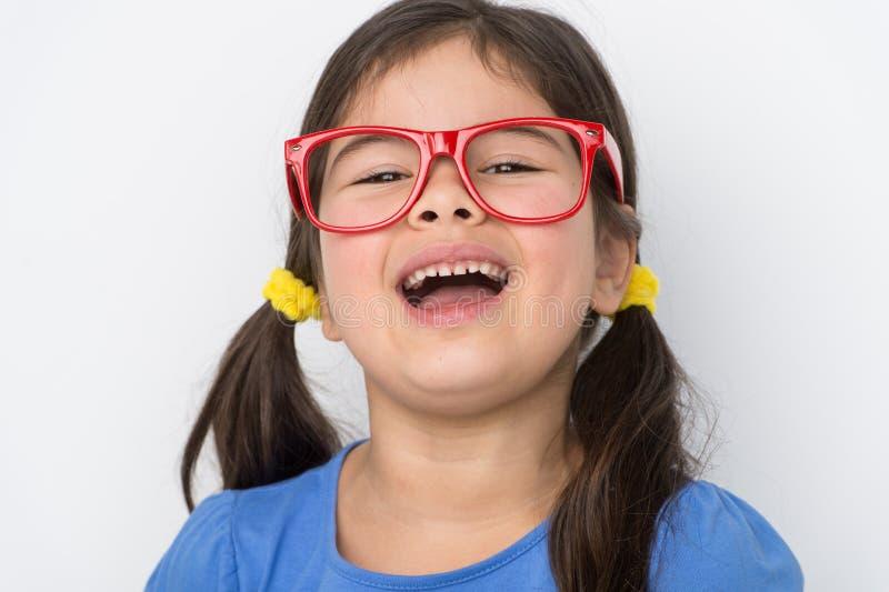 Vidrios que llevan de la niña agradable imagenes de archivo