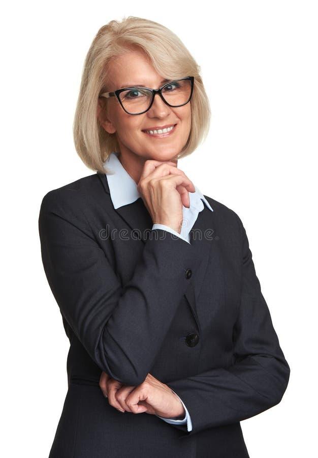Vidrios que llevan y sonrisa de la empresaria mayor imagen de archivo