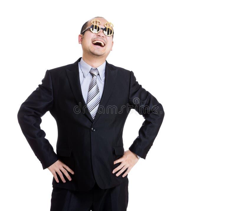 Vidrios ricos felices de la muestra de dólar del desgaste del hombre de negocios foto de archivo libre de regalías