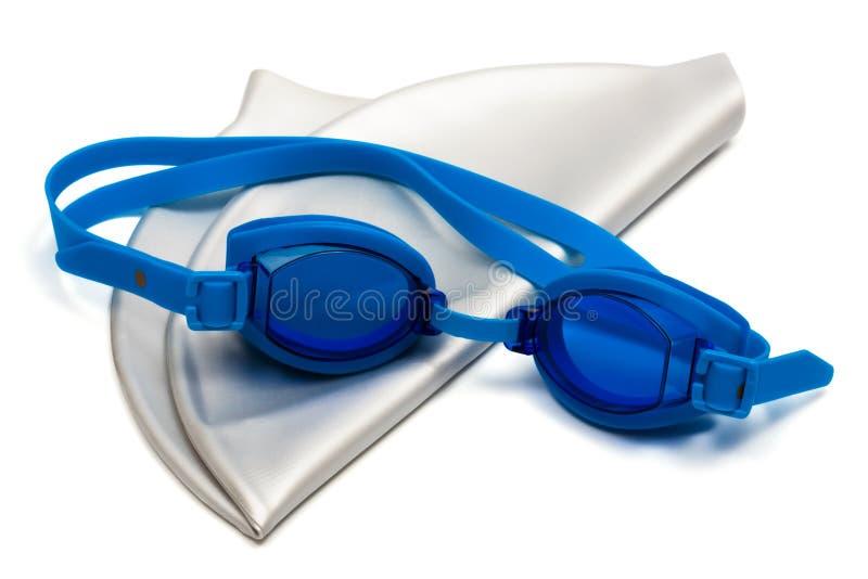 Vidrios y casquillo para la natación imagenes de archivo