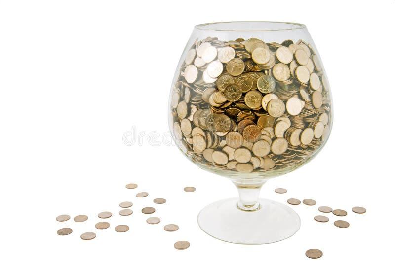 Vidro com dinheiro fotos de stock royalty free