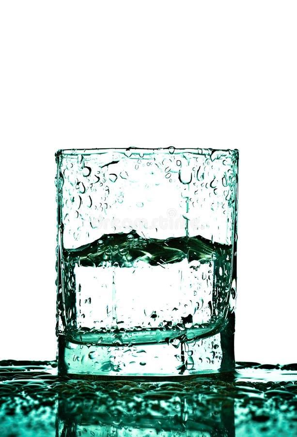 Vidro com gotas da água foto de stock