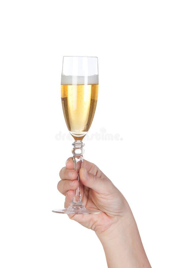 Vidro da terra arrendada da mão do champanhe foto de stock royalty free
