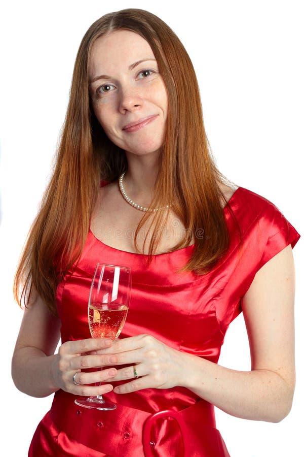 Vidro da terra arrendada da mulher nova do champanhe fotos de stock