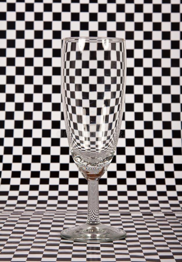 Vidro de Champagne no fundo da verificação fotos de stock royalty free