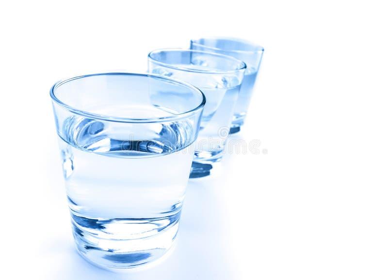 Vidro de três bebidas com conceito da água, da nutrição e dos cuidados médicos fotografia de stock royalty free