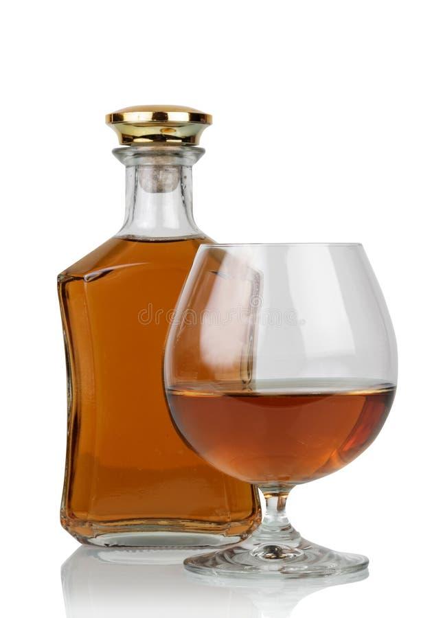 Vidro do conhaque com garrafa imagem de stock