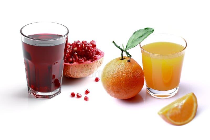 Vidro do suco do suco de laranja e da romã foto de stock