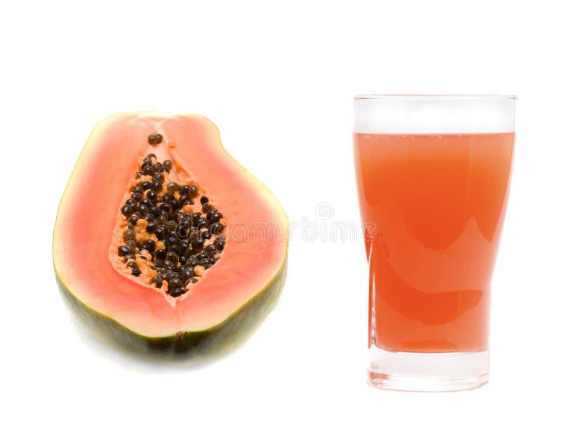 Vidro do suco de papaia imagens de stock