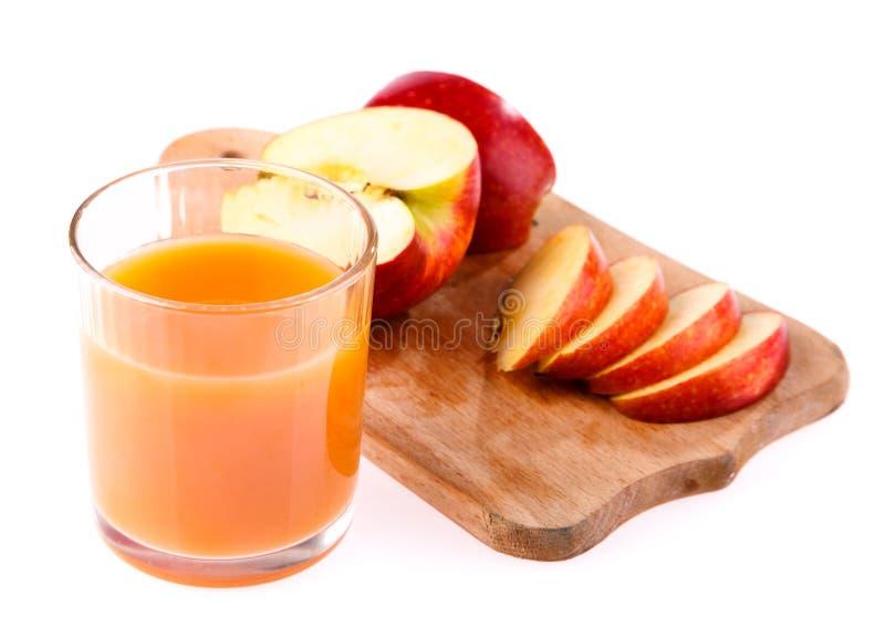 Vidro do suco e da maçã imagens de stock