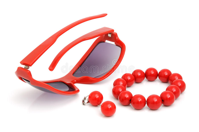 Vidros, bracelete e brincos fotografia de stock