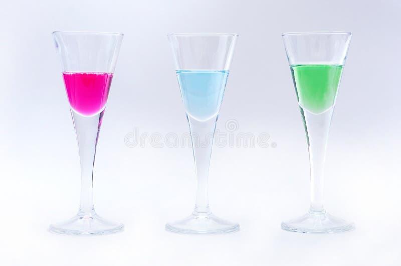 Vidros com líquidos da cor fotos de stock