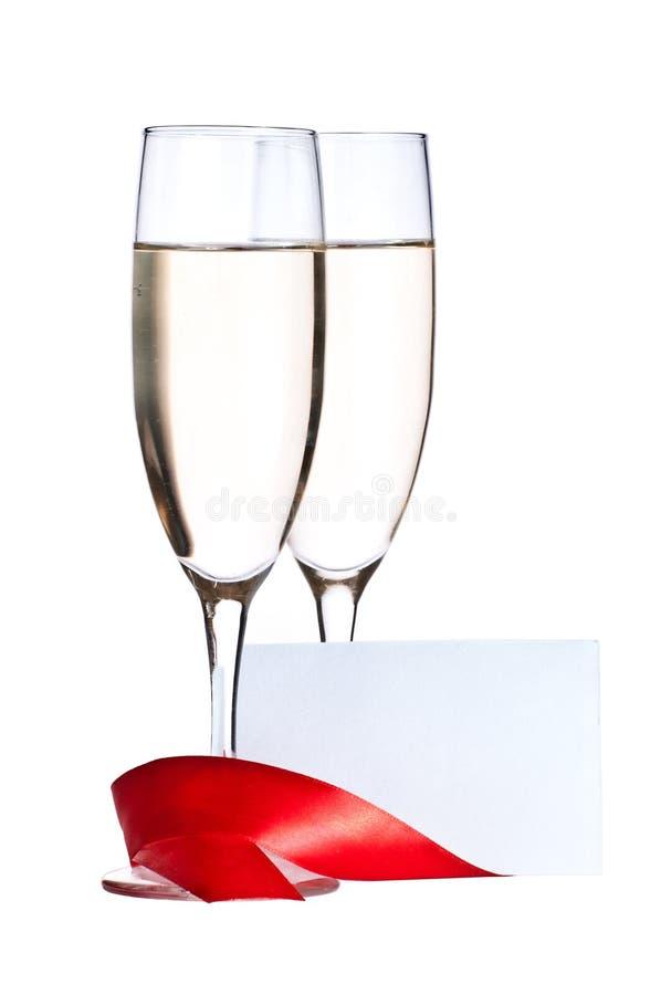 Vidros com o cartão de Champagne e de convite fotos de stock royalty free