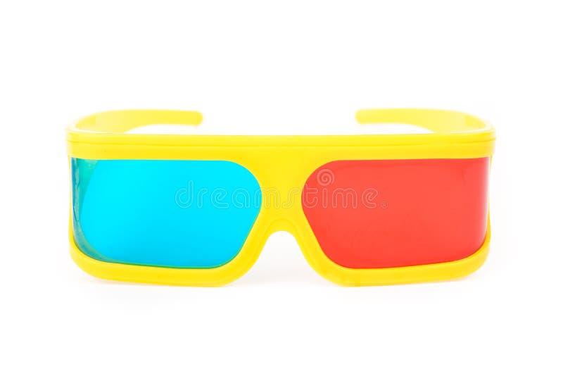 Vidros 3d plásticos amarelos isolados no branco imagem de stock royalty free