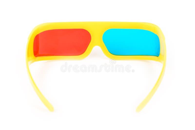 Vidros 3d plásticos amarelos isolados no branco fotografia de stock