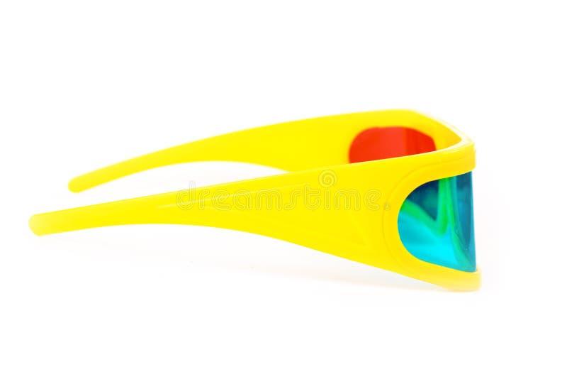 Vidros 3d plásticos amarelos isolados no branco fotos de stock