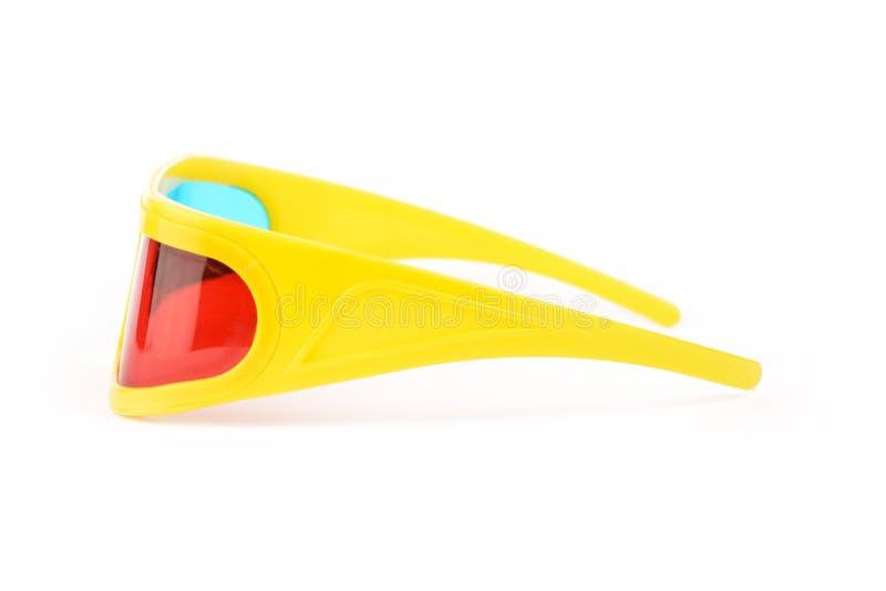 Vidros 3d plásticos amarelos isolados no branco fotografia de stock royalty free