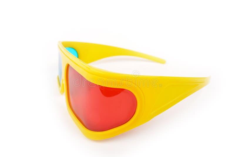 Vidros 3d plásticos amarelos isolados no branco foto de stock royalty free
