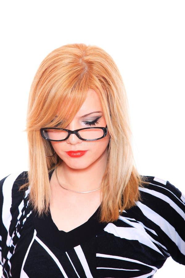 Vidros desgastando da mulher de negócio foto de stock