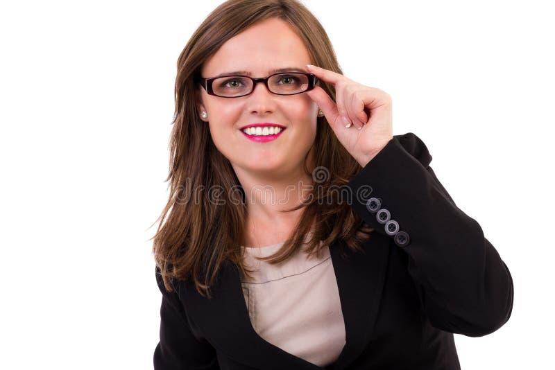 Vidros desgastando novos de sorriso da mulher de negócio imagem de stock