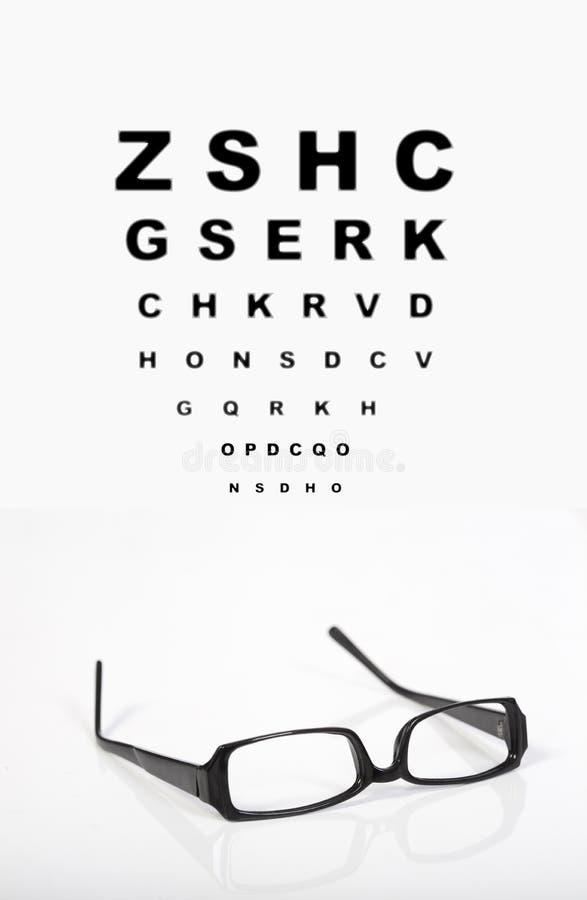 Vidros do olho e carta de teste imagem de stock