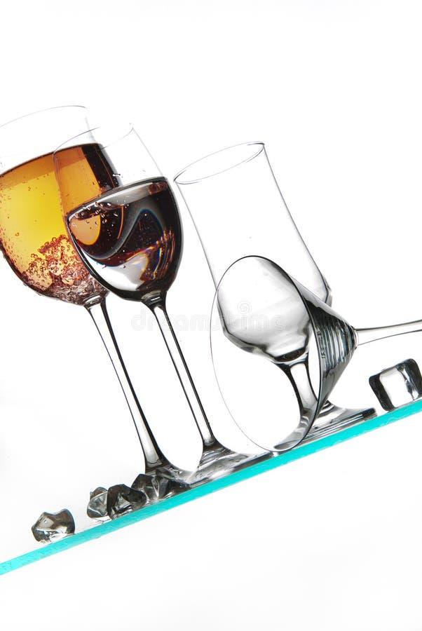 Vidros e líquidos imagem de stock