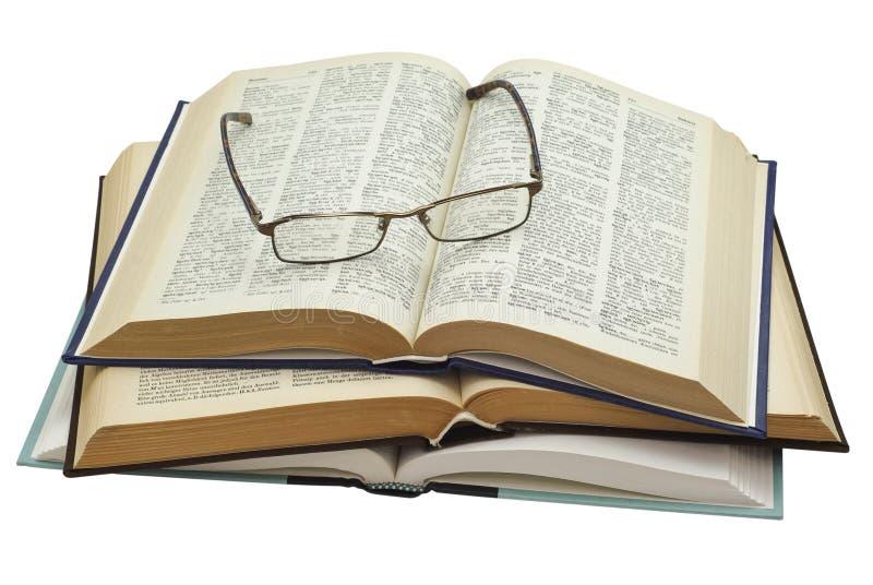 Vidros em três livros abertos foto de stock royalty free