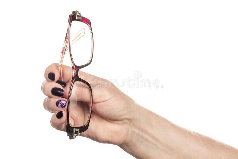 Vidros na mão fêmea fotografia de stock royalty free