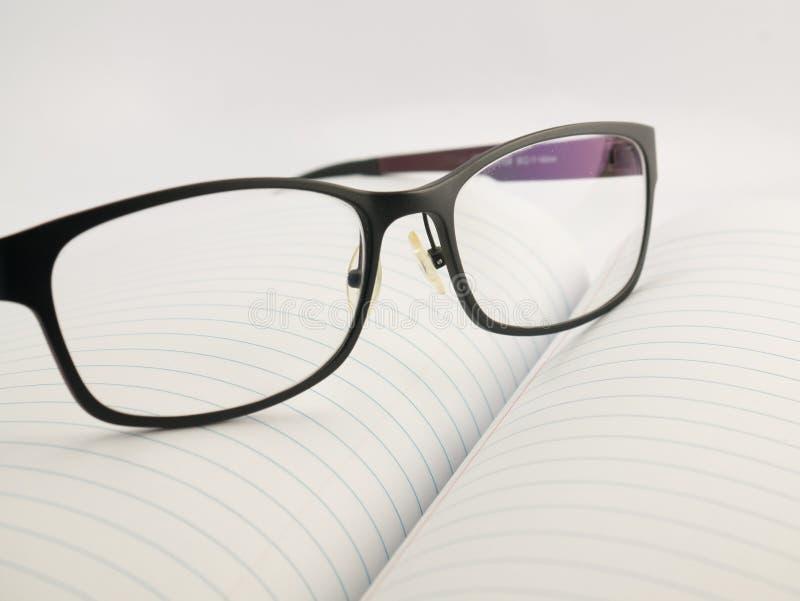 Vidros no caderno imagens de stock royalty free
