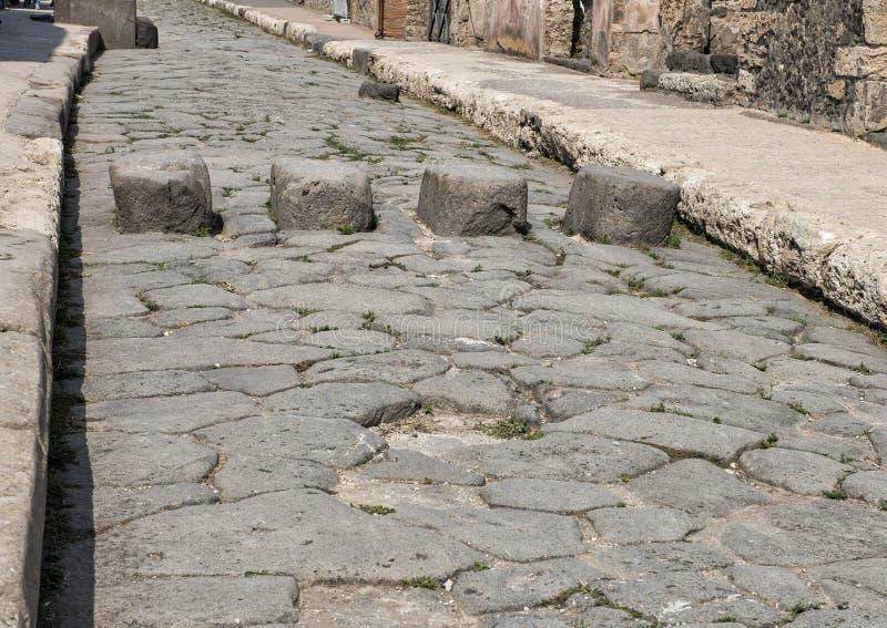 Vie con le pietre facenti un passo, Di Pompei di Scavi fotografie stock libere da diritti