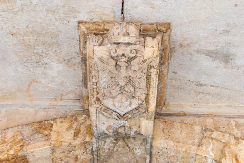 Vieil aigle polonais Symbole national sur le mur en pierre images libres de droits
