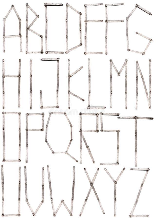 Vieil alphabet de lettre de règle de mètre de fer images stock