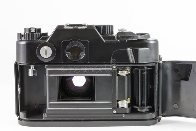 Vieil appareil-photo de 35mm SLR avec la couverture de dos nu images libres de droits