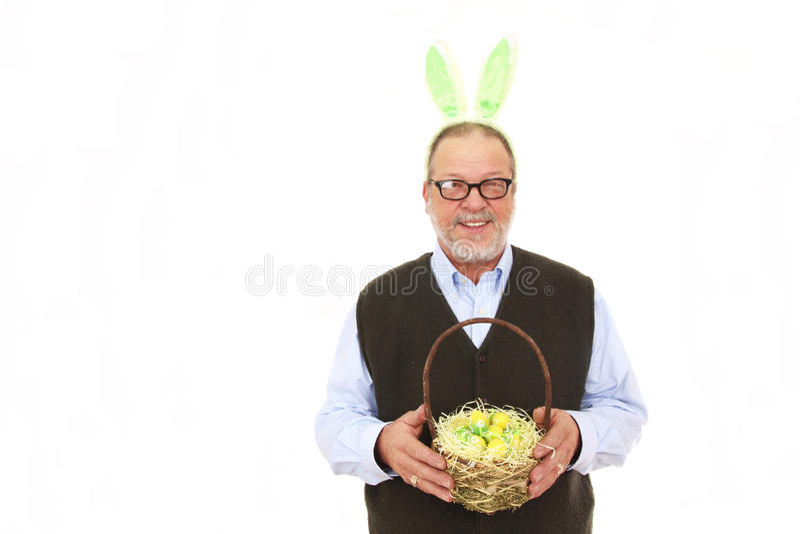 Vieil homme avec des oreilles de lapin photographie stock libre de droits