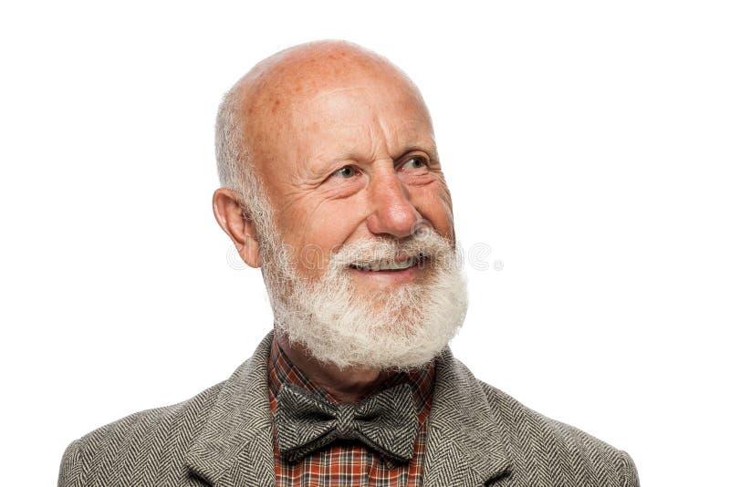Vieil homme avec une grande barbe et un sourire photos libres de droits