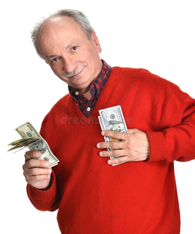 Vieil homme chanceux tenant des billets d'un dollar images stock