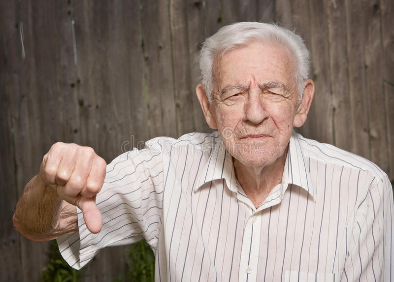 Vieil homme grincheux photos libres de droits