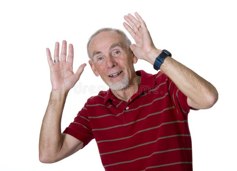 Vieil homme ondulant avec les deux mains image stock
