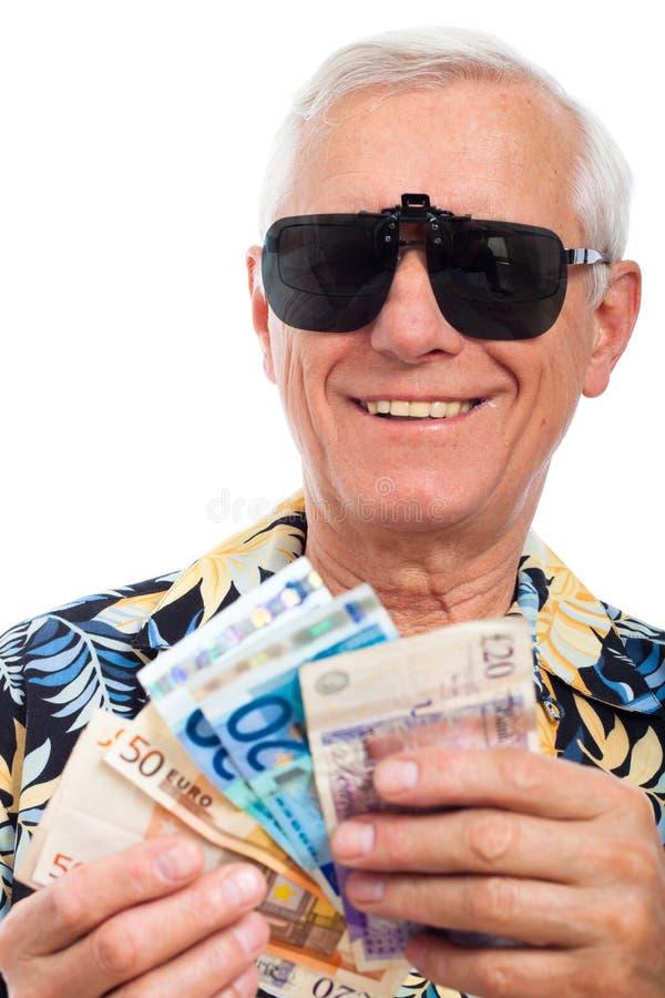 Vieil homme riche heureux avec de l'argent photographie stock libre de droits