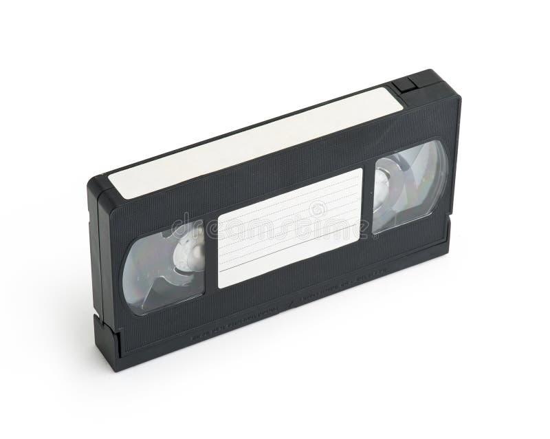 Vieille bande vidéo en cassettes de VHS avec l'étiquette blanc photographie stock libre de droits