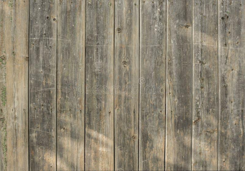 Vieille barrière brune en bois pour le fond des panneaux de différentes largeurs images stock