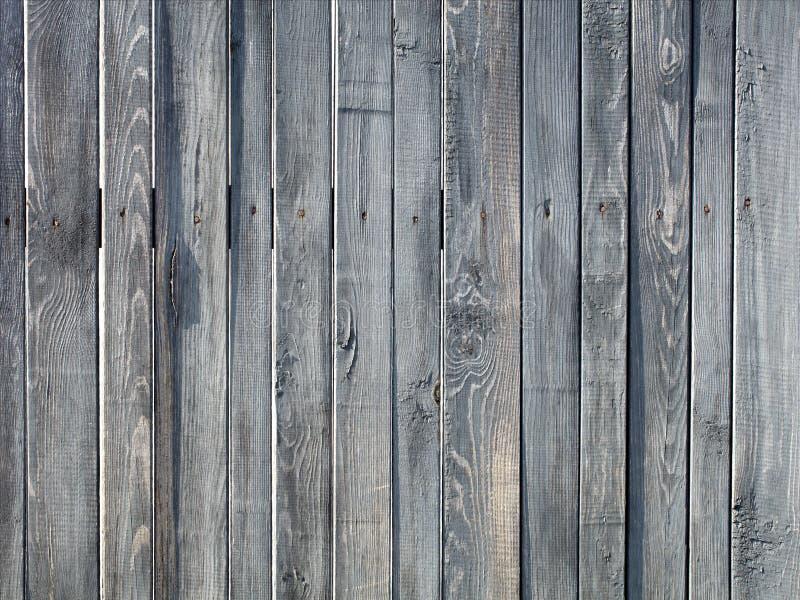 Vieille barrière en bois grise superficielle par les agents photo stock