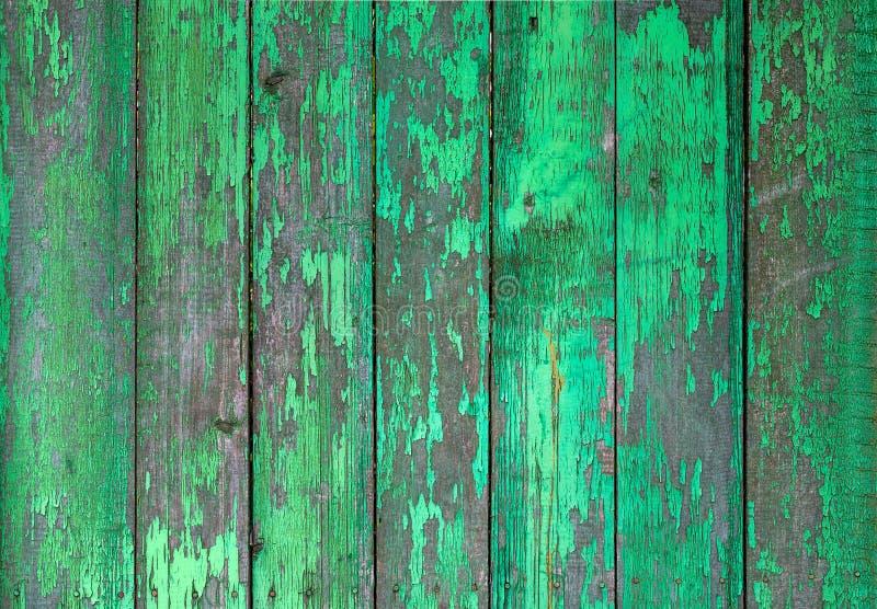 Vieille barrière rustique vert clair peinte en bois, fond d'épluchage de peinture photos stock