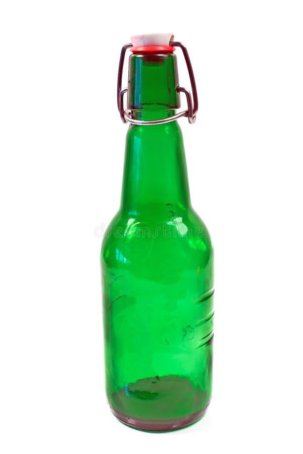 Vieille bouteille brune avec le dessus d'oscillation images stock