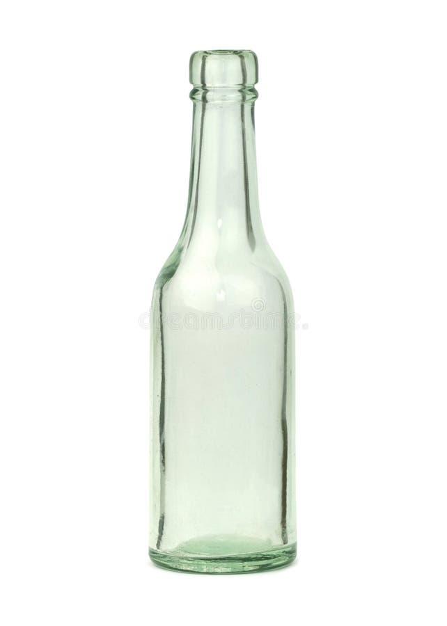 Vieille bouteille en verre d'isolement sur le fond blanc image stock