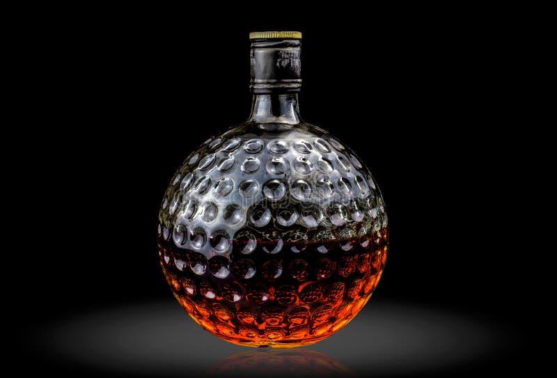 Vieille bouteille en verre de whisky écossais photographie stock